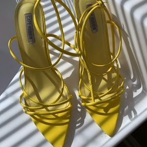 Yellow strappy heels